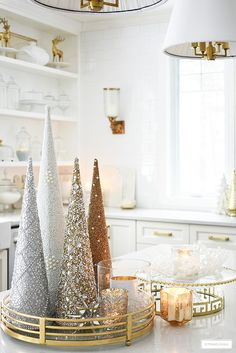 Glittery trees gathered on a tray with mercury glass candles makes a glam statement! Glittery trees gathered on a tray with mercury glass candles makes a glam statement! Elegant Christmas Decor, Silver Christmas Decorations, Farmhouse Christmas Decor, Classy Christmas, Christmas Home, Holiday Decor, Holiday Style, Apartment Christmas Decorations, Christmas Decorating Ideas