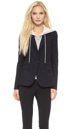 The 2-way zip hoodie inset detaches with hidden zips at the interior. Brilliant, I tell you, just brilliant. You get the layered look without the bulk. Veronica Beard Jacket. Yours for only $695 (gag)