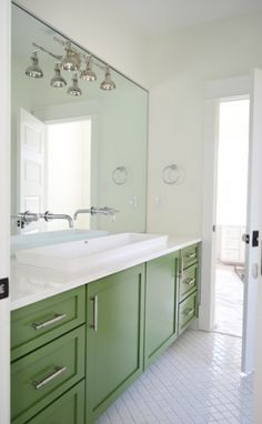 love // small white trough sink with classic vanity cabinet for