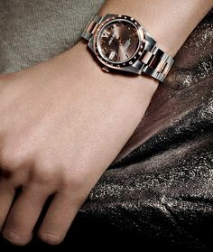 A Rolex Datejust 31 in steel and 18ct Everose gold with a chocolate dial and diamond-set bezel.