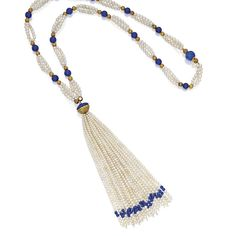 GOLD, NATURAL PEARL AND LAPIS LAZULI NECKLACE The triple-strand necklace spaced by lapis lazuli beads and gold beads decorated with granulation, suspending a tassel, composed of numerous pearls ranging in size from approximately 4.0 to 1.9 mm, length 25 inches.