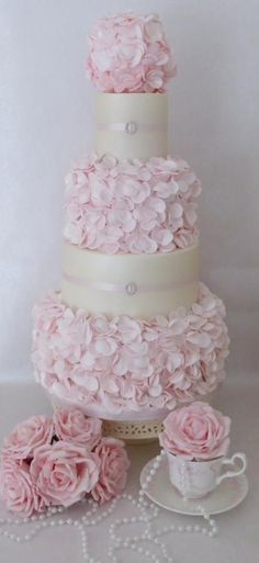 Pretty pink ruffle wedding cake ~ all sugar roses as well ~ all edible. ᘡղbᘡ
