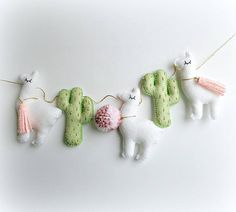 MADE TO ORDER Green & Gold Cactus and white Llama garland with pink details --------------------------------------------------------------------------------------- Each cactus measures - approx. 9 cms tall and approx. 6 cms wide (at largest points) / 3.5 inches tall and 2.5 inches wide. Each Llama measures - 9.5 cms tall and 8 cms wide (at largest points). GARLAND details: ------------------------- Each happy llama and cactus is strung onto a gold string, approx. 1.5/2 meters l...