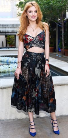 Bella Thorne in a matching floral crop top and midi skirt.