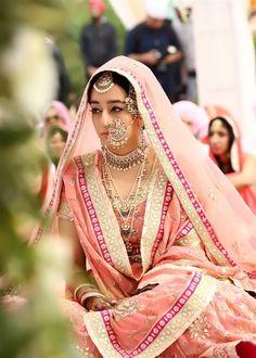 Elaborate nosering , pastel pink bride, sikh bride,