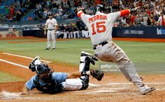 Luke Maile #46 of the Tampa Bay Rays tries to make the tag on Dustin Pedroia #15 of the Boston Red Sox at home plate as Pedroia scores the winning run in the tenth inning of their game at Tropicana Field on September 25, 2016 in St. Petersburg, Florida.