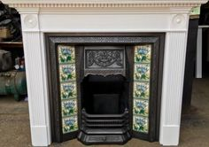 Victorian-Style-Tiled-Cast-Iron-Fireplace-With-Painted-Wooden-Surround