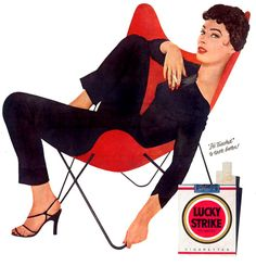 Liz Taylor, smoking Lucky Strikes in a Hardoy Butterfly chair.