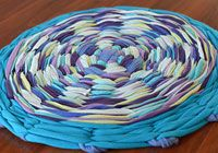 Use a hoola hoop and old t shirts to create a rag rug.