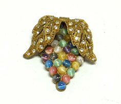 Buy Pastel Leaf Clip - Dress Clip Brooch - Art Nouveau with Goldtone Leaves, Rhinestones & MoonGlow Beads by thejewelseeker. Explore more products on http://thejewelseeker.etsy.com