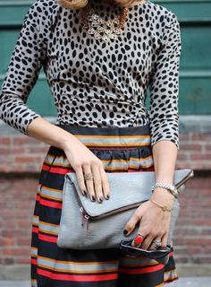 Elongate your frame with a striped A-line skirt and an animal print wrap shirt.