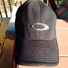 Black Oakley baseball hat/cap Pre owned   In very good condition.  Some  light marking under cap.  See pictures.  A flex L/XL size on tag. 100 polyester Oakley Accessories Hats