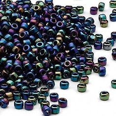 Seed bead, Dyna-Mites™, glass, transparent rainbow multi-iris, #8 round. Sold per 40-gram pkg. - Fire Mountain Gems and Beads