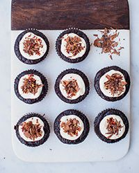 These delicious, gluten-free chocolate fudge cakes are topped with a tangy yogurt frosting.