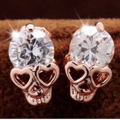 2 left!!! Rhinestone skull earrings  Super cute earrings $8.00 a pair! Ask me about bundle deals!  NO TRADES and PRICE IS FIRM unless bundling!! Happy Poshing ❤️ Jewelry Earrings
