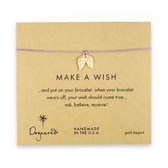 Dogeared. make a wish bracelet with gold dipped angel wings on lilac