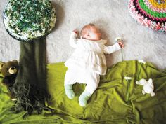 While her baby sleeps, mom makes infant into art