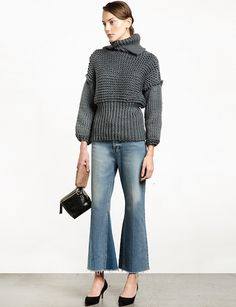 Sometimes we come across a piece so good, we have to share it. This is one of those times. There's no need to get bored with your winter sweaters when unique pieces like this exists. This balloon sleeved, chunky, cropped turtleneck sweater is just what you need.