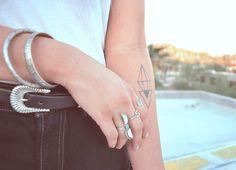 Geometric tattoo (logo of a jewelry line) on the arm