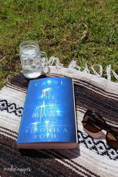 The latest book from the author of Divergent, Veronica Roth, is Carve The Mark - and it's one you'll definitely want to check out if you're a sci-fi fan!