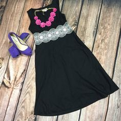 LOFT Black Dress The Little Black Dress with a dash of lace! This dress is 38 1/2 inches long with a 14 inch waist. It has a 13 inch hidden zipper on the side and a 6 inch v-neck. It also has a cute lace belt to add just the right touch to any outfit. LOFT Dresses