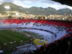 The largest soccer flag in the world belongs to Colombian team Independiente Santa Fe. It measures 350 x 33 meters! Colombian Culture, Soccer Flags, World, Grande, Football, Recipes, Santa Fe, Bogota Colombia, Strength