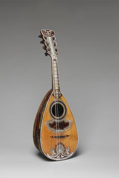 Mandolin by Antonio Vinaccia (Italian, active 1754–1781) Mandolin, 1781 Spruce, tortoiseshell, mother-of-pearl, gold alloy, ivory; L. 23 in. (58.4 cm) The Metropolitan Museum of Art, New York, The Crosby Brown Collection of Musical Instruments, 1889 (89.4.2140)