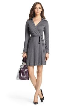 This classic wrap dress in a lightweight wool knit is chic and effortless for fall. True wrap style with self-tie waist and collar. Falls to above the knee. Fit is true to size.