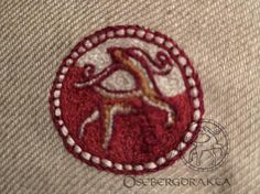 Oseberg textile - Embroidery 12 B1 5.6x3cm The animals are placed back to back, with the heads facing each other Silk thread embroidery The frames were sewn with a bead-like seam Colors likely: Red-brown, brown, bronze and red This kind of naturalistic representation of animals in embroidery does not occur in Nordic art at this time The S-shaped volutes appear extensively in Irish and Anglo-Saxon manuscripts The motif with an animal figure in a circular beaded medallion is of oriental origin Nordic Art, Anglo Saxon, Brown Brown, Silk Thread, Vikings, Irish, Oriental, Frames, Bronze