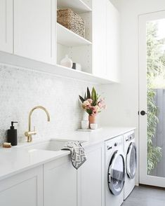 Gorgeous Laundry Room with Marble Penny Tile Backsplash, White Cabinets and Gray Tile Floors / Adore Home Magazine room cabinets above washer LITTLE WILLOW — Adore Home Magazine White Laundry Rooms, Modern Laundry Rooms, Laundry Room Layouts, Laundry Room Remodel, Farmhouse Laundry Room, Small Laundry, Small Utility Room, Laundry Decor, Laundry Room Organization