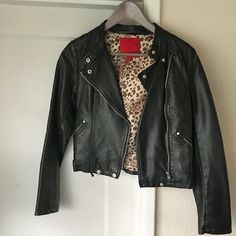 """Faux Leather Cropped Jacket Cropped - approx 19.5"""" from neckline to hem. Sleeves are approx 23.5"""" long with zipper detail on each. Lined; liner is animal print and 100% polyester. Faux leather shell is 100% polyurethane. Zipper and snap details throughout jacket. One snap at hem is worn - see pics. Otherwise, jacket is like new - only worn 2 or 3 times. 5/48 Jackets & Coats"""