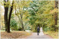 Wedding photo of bride and groom walking through woods | Pittsburgh wedding photographers
