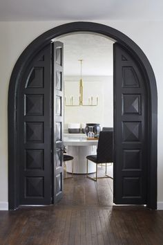 """Leanne Ford Interiors for HGTV's """"Restored By The Fords"""" - The McCalister Project - Construction by Steve Ford - Shot by Reid Rolls Arched Interior Doors, Arched Doors, Arch Interior, Interior Design, Gothic Interior, Ford Interior, Dark Interiors, Black Doors, Hgtv"""