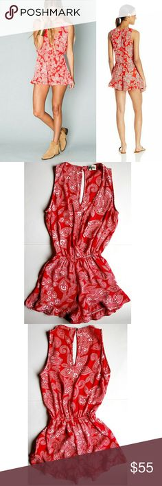 """Show Me Your Mumu Riri Romper Best selling sleeveless romper with cross body detail and ruffle shorts. Color is Aquarius Paisley.   100% Polyester. Dry Clean Only 16.5"""" across chest,  12"""" waist, 26"""" long shoulder to bottom hem,  2"""" inseam.   In excellent condition. Show Me Your MuMu Pants Jumpsuits & Rompers"""