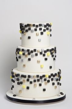 Fondant cubes in black, gold, silver and yellow cascade down the sides of this modern Sugar Couture wedding cake.