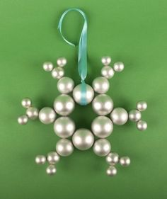 Ornament Snowflake Wreath | Decorating for the holidays doesn't have to be stressful. Deck the halls with these effortless (yet impressive) Christmas crafts.