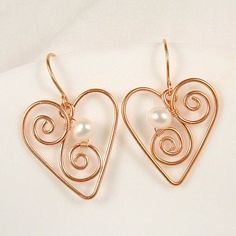 Heart Earrings - aww, these are so pretty! (they'd have to be small though or else they would look funny on me). :)