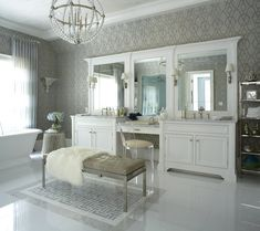 A dream-worthy bath room with plenty of seating.