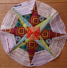 Fun star block. Looks like a good challenge for construction of inside corners.