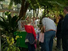 Interacting with visitors at the orchid discovery cart on the opening day of Orchid Mystique at the U.S. Botanic Garden. (February 2012)