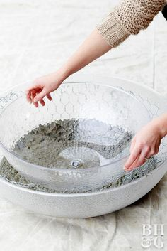 A small, handmade fire bowl brings ambiance and warmth to an outdoor setting. Simply cast a fire bowl in a mold and add fuel gel for a DIY yard accent. Large Concrete Planters, Concrete Bowl, Cement Pots, Concrete Garden, Diy Planters, Succulent Planters, Succulents Garden, Concrete Crafts, Concrete Projects