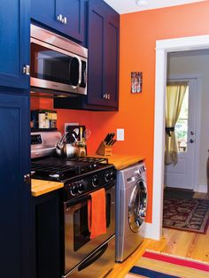 Harbinger kitchen area leading to optional bedroom in back | Tumbleweed Tiny House Company