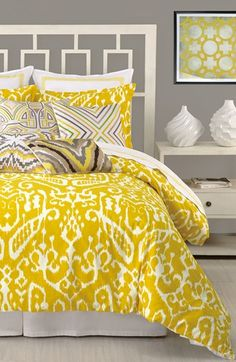 Absolutely loving this yellow + gray color palette, these awesome patterns, and that modern headboard!