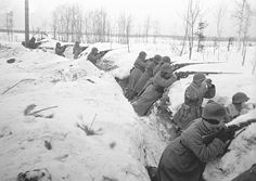 Soviet soldiers of 7th army fire on the enemy from a trench on the Karelian Isthmus, 1939.