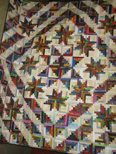 New England Log Cabin made by Buckjo. Design by Judy Martin. Pattern is in her Stellar Quilts book. This quilt is available for sale on etsy.
