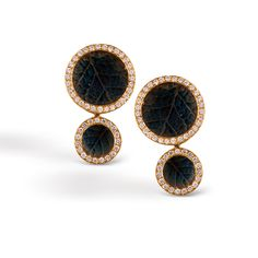 #Organic Allure Collection These luxurious 18K yellow earrings add .55ctw of round white Diamonds to this uniquely colorful pattern. DE181
