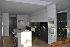 Eclectic Interiors is a Kitchen Designer in London, Clapham. Our kitchen company provides bepoke shaker kitchens, bathrooms and custom made furniture. Shaker Kitchen, Kitchen Units, Mirror Splashback, Copper Handles, Contemporary Kitchen Design, Custom Made Furniture, White Porcelain, Graphite, Slate