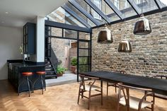 >> The architects chose Crittall-style glazing to encase the single-height space. These black gridded frames also encompass a mono-pitched glass roof. Highbury Hill extension by Blee Halligan Architects. We love the bare brick at reroom uk House Design, New Homes, House Extensions, Victorian Homes, Victorian Terrace House, Crittal Windows, House, Home, London House