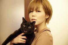 Singer/Designer MEG × RIU — Her Feline Bodyguard