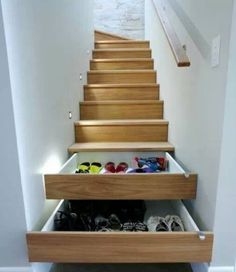Staircase storage. I want this when we buuld our own home in 10 years. Perfect place for shoes and mittens.